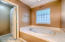 Large jetted tub in master bathroom