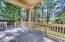 Composite deck overlooking beautiful backyard and greenbelt beyond