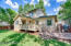 Large backyard with deck, separate dog run, and large storage shed