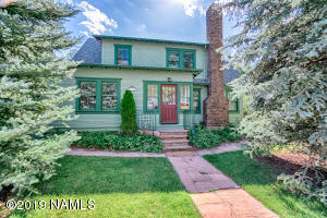 Beautiful front entry of this historical home, with a mature landscaped yard. The chimney with dry stack stone is amazing