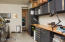 wonderful built in shelving and drawers in the garage
