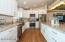 Kitchen has easy roomy flow. Easy close cupboards and drawers