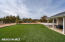 Large yard ends at large sand play yard and basketball court