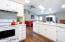 Wood Floors, Breakfast bar over looking the spacious Family Room