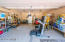 Large, insulated two-car garage has a sealed concrete floor and automatic garage door.