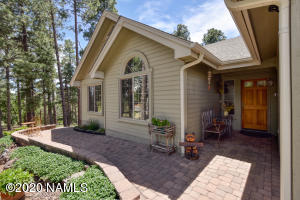 This one owner home has been lovingly cared for and it shows! Photo of front exterior and patio