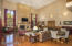 Massive ceiling height, wet bar, gorgeous wood floors and French doors out to covered patio