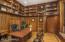 Rich wood paneling and a secret hidden room!
