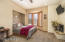 Lower level bedroom w/ Fireplace, private bath and private entrance perfect for a nanny suite or mother in law suite.