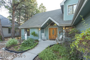 Front yard is professionally landscaped and has an irrigation system.