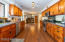 Hardwood floors stretch through to the walk-in pantry and garage.