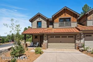 Expansive Forest and Golf Views set the scene for this picturesque Flagstaff Townhome