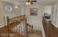Handsome Natural Wood Railings and Rich Laminate Flooring