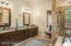 Master bathroom is complete with a large soaking tub, dual sinks, and fine finishes.
