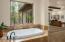 Large soaking tub in master bathroom.