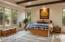 Exquisite master bedroom has en-suite bathroom, large walk-in closet, art niche with Juniper, and door to the back patio.