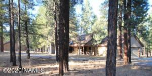 Custom home in the pines. One owner-Move in ready. Separate shop & barn