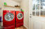 Beautiful washer and dryer in mudroom off of kitchen and access to back yard