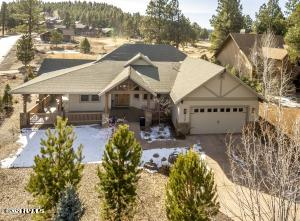Over 1/3 acre with great views of the Peaks and golf course