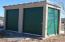 Storage shed on a concrete slab with oversized doors