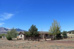 Single level home on acreage with horse privileges.