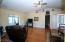 Spacious living room with vaulted ceilings. Ceiling Fan. Pellet Stove. Easy care flooring