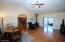 Spacious living room with vaulted ceilings. Pellet Stove. Easy care flooring. Ceiling Fans.