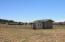 Shed and separate hay/tack/storage. Corral.