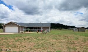 Well cared for ranchette on 2.5 acres. Perimeter fenced. Horse Set-up