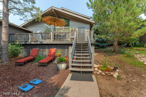 Outside Entertaining Deck and Relax on lower yard under awesome Spruce!