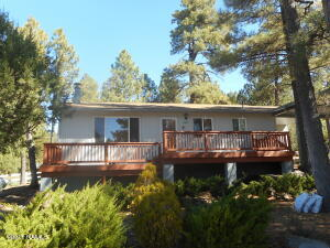Forest Escape on large lot with ample parking and carport.