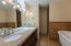 Double sink, shower and soaking tub