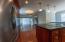 Open floor plan with hardwood floors throughout