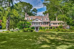 1927 Brick Georgian estate with slate roof sits on 10.13 private acres on the upper west side of New Canaan.