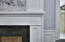 A close up view of the fireplace in the master bedroom. All fireplaces in this home can either be utilized as wood burning or gas.