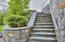 Master masonry with beautiful stone staircases and landscaping beds.