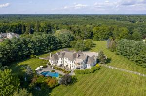 Spectacular private estate sited on one of New Canaan highest points.