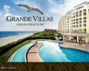 Back view of Grande Villas showing pool, clubhouse and ocean views.