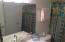 New commode, resurfaced shower-tub with new fixtures as well.