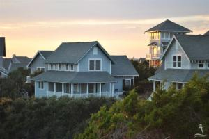 """Named """"Sunday Morning """", nestled in the high dunes in the award winning Floras Bluff /Killegray Ridge community. A great rental or permanent residence with an extra guest bedroom above the garage."""