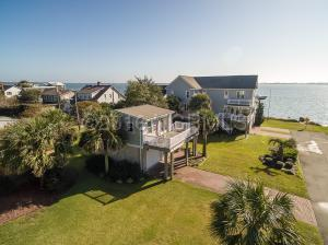 Soundfront home, detached carriage house and an extra lot. This one-of-a-kind offering features 2.5 lots from Bogue Sound to Shepard Street.