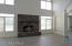 Huge Family Room with Brick Gas Fireplace, Palladian windows and tile floor