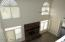 Wall of Windows and Brick Fireplace in Family Room from Balcony on 2nd Floor