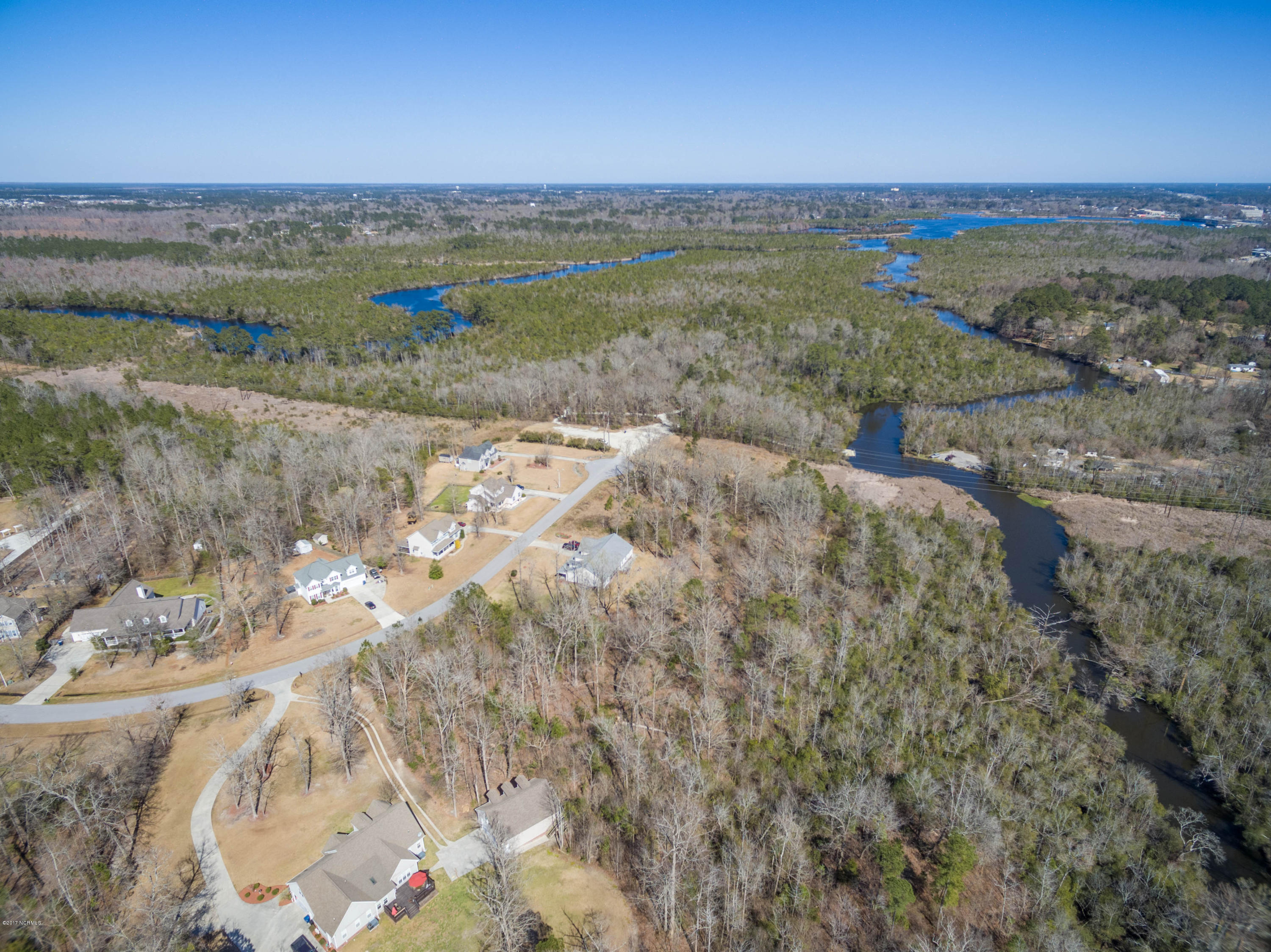 Nestled in established and desirable Oakhurst River Estates is where you will find this large lot. This great piece of land offers frontage on Blue Creek with access to New River and the Ocean! Located near MCAS New River, shopping, restaurants and much more in an up and coming area!