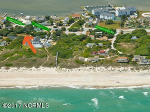 See the red arrow. The lots are third row ocean side that feature a private path to the beach. No crossing a busy road!