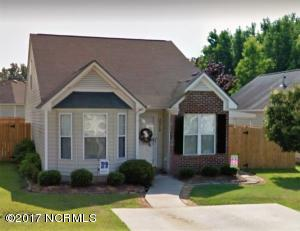 beautifully landscaped front yard with large double parking pad.