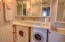 Guest bathroom - washer & dryer beneath the sink