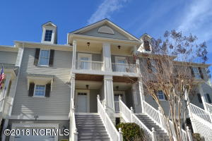 Stately front view of Townhome.