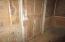 insulation, flat-panel wainscoting, original door in living room