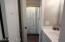 Hall Half Bath - door to shared Tub/Shower